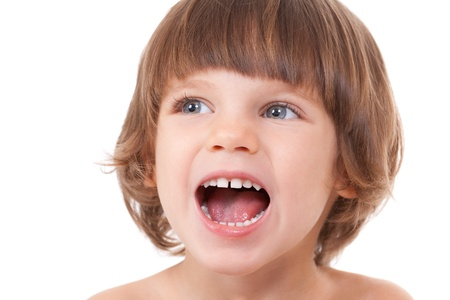 Studio portrait of a close-up of a girl with her mouth open with joy. Isolate on white.