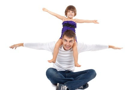 Handsome father with his little daughter on his shoulders happily laughing in the studio. Isolate on white. photo