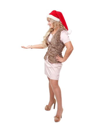 25s: beautiful blonde girl wearing a Santas hat standing with her hand up, place your product here