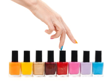 nail care: Female hand fingers are the colored paints polish isolate on a white background Stock Photo