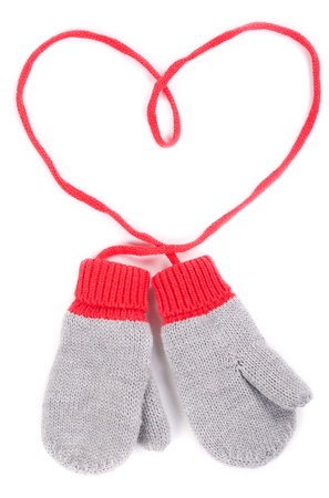 pair of gray baby mittens on a string in the form of heart. Isolate on white background. photo