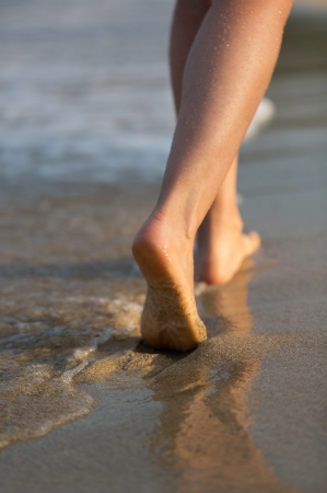 young girl feet: Human legs. Beautiful woman walking on the beach