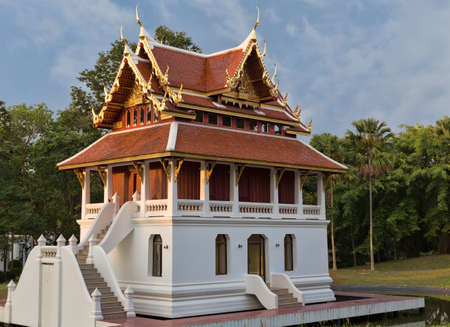 beautiful little Thai temple in the forest setting sun Stock Photo - 18081349