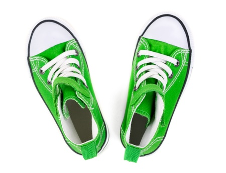 Green sneakers on a white background. Top view Stock Photo - 18679465