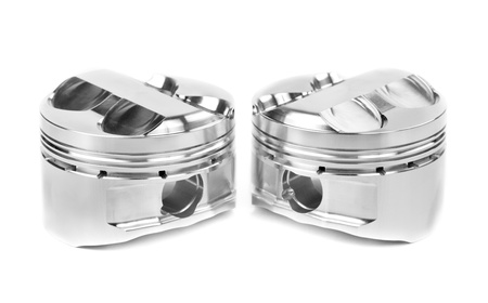 set of two polished forged pistons. Isolate on white. photo