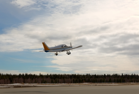 fixed wing aircraft: Small Plane Taking Off at a Local North Airport