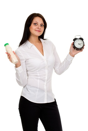 25s: beautiful girl with yogurt and clock isolated on white Stock Photo