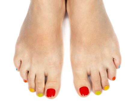 Female feet with a pedicure color on a white background photo