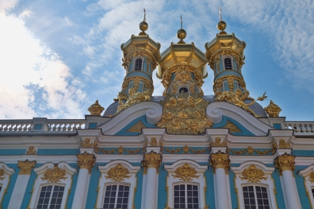 atlantes: Golden domes of Catherine Palace close-up on a background of blue sky with clouds. St. Petersburg, Russia.