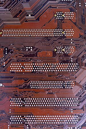 A close up shot of a computer brown motherboard. photo