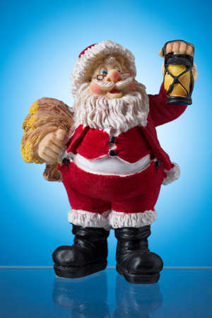mysticism: Santa claus figure on blue spots, mysticism Christmas. Stock Photo