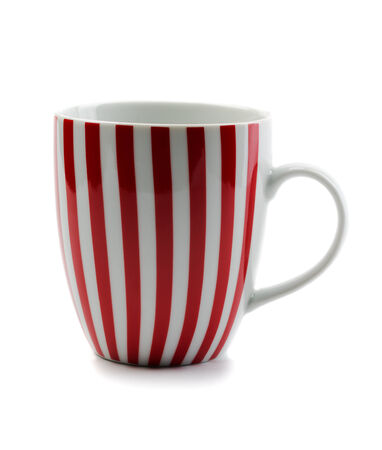 Porcelain cup red stripes. Isolate on white.