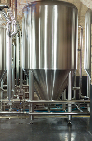 Stainless steel tank at the brewery for the fermentation of beer. photo