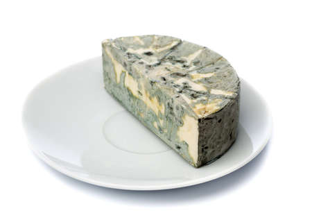 black mold: Cheese with black mold on a plate for food lovers. Isolate on white.