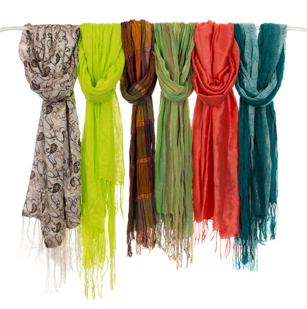 scarves: Silk colored scarves on a hanger. Isolate on white. Stock Photo