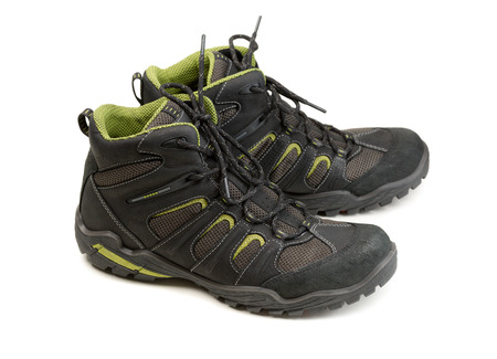 hillwalking: Pair of modern high-tech winter trekking shoes. Isolate on white. Stock Photo