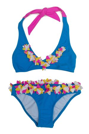 two piece bathing suit: Blue childrens swimsuit with colored patches. Isolate on white. Stock Photo