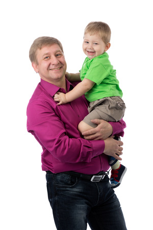three year old: Portrait of a father and three year old son in the studio. Isolate on white. Stock Photo