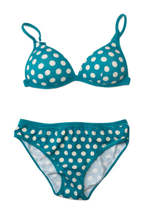 two piece swimsuits: Blue swimsuit with polka dots. Isolate on white. Stock Photo