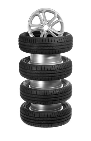 vulcanization: A stack of car wheels and tires. Isolate on white.