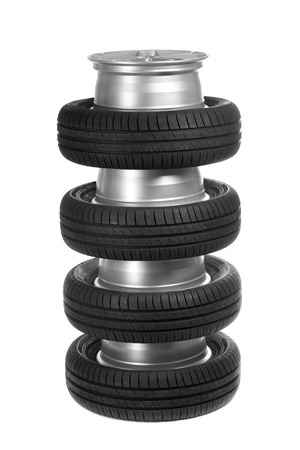 vulcanization: Stack of car wheels and tires. Isolate on white. Stock Photo