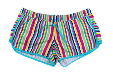 swimming costumes: Colored striped shorts. Isolate on white