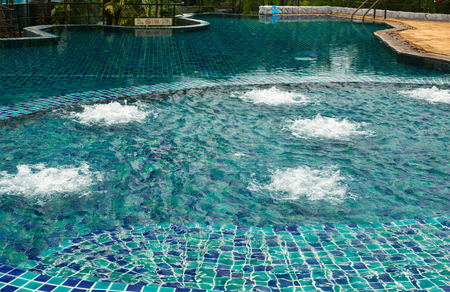 luxuriously: Swimming pool with hydro massage with tropical paradise of Thailand. Stock Photo