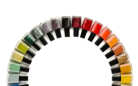 semicircle: Bottles with nail polish arranged in a semicircle. Isolate on white.