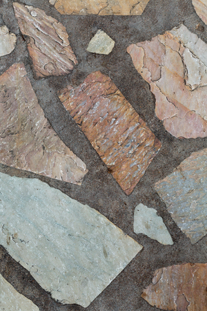 Background of stone and concrete, red granite. Stock Photo