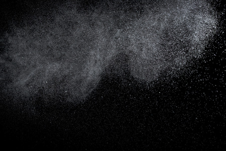 sprayed: Water is sprayed randomly on a black background.