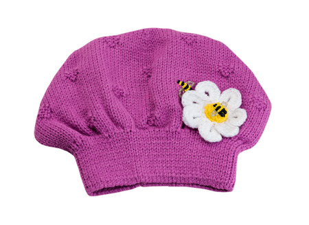 Pink knitted hat beret. Isolate on white. Stock Photo