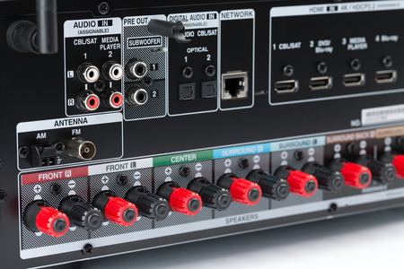Closeup of the back of an AV receiver, showing the speaker terminals, component connectors. Audio receiver, isolate on a white background, studio 版權商用圖片