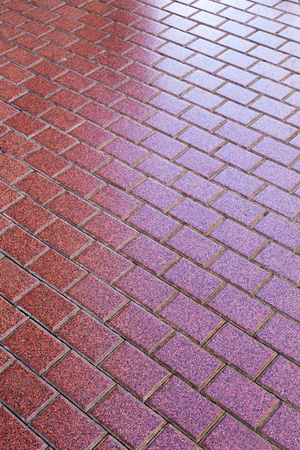 Granite pavers backlit receding into the distance