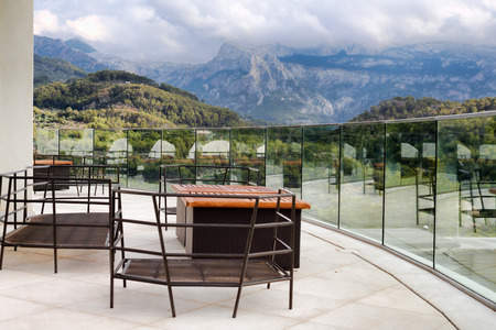 steep: Balcony overlooking the mountains with clouds Stock Photo