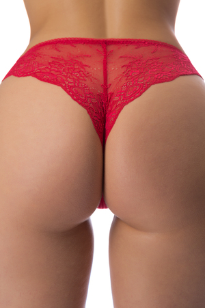 Women's butt in red panties close-up. Studio. Isolate on white photo