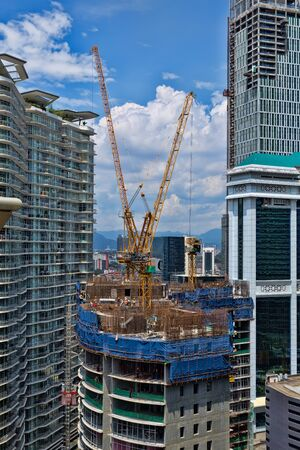 Construction of a skyscraper in a city with cranes