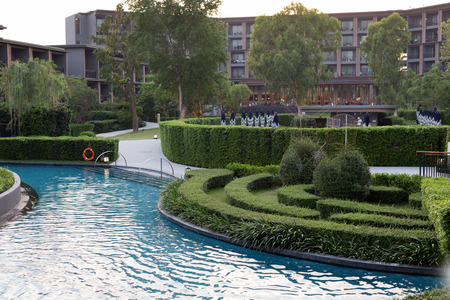 Swimming pool on the building background and landscape design