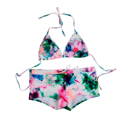 Female color swimsuit with a floral pattern. Isolate on white background