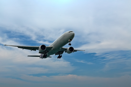Airplane in the sky close up Stock Photo