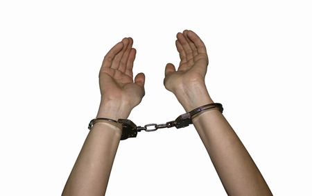 sadistic: police handcuffs on the hands of women a crime and a crime white background