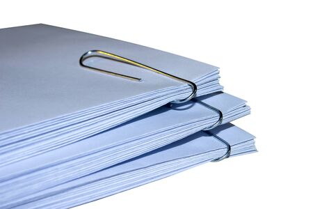 square tape: A stack of envelopes with paper clips on white background office supplies Stock Photo