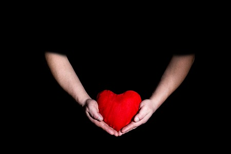 tenderness: mens hands hold heart Valentine day Stock Photo