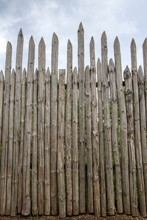 Ancient wooden fence with sharp tops for protection