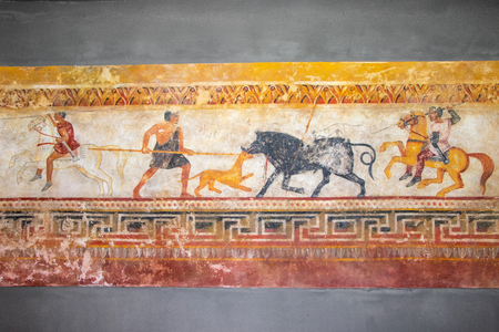 wall drawings of life and hunting of ancient people and animals