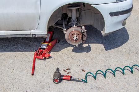 car repair wheel replacement in a car repair shop