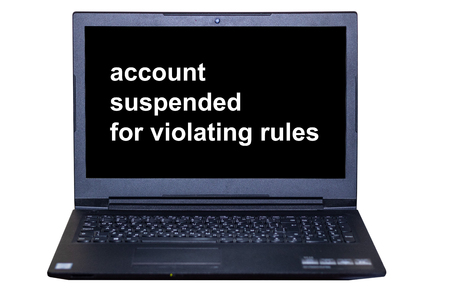 laptop monitor text-account suspended for violating rules on a white background
