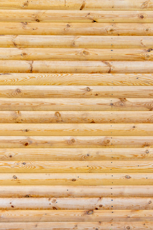 wooden background of freshly treated wood logs