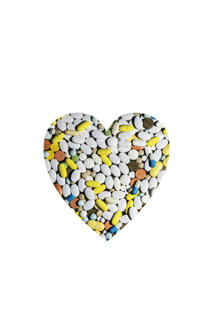 colored pills for treating diseases and addiction in the form of the heart 写真素材