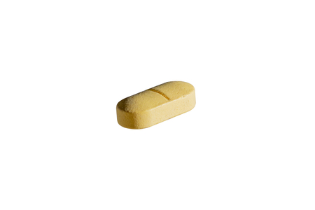 yellow pill for treating disease on white background isolated Stock Photo