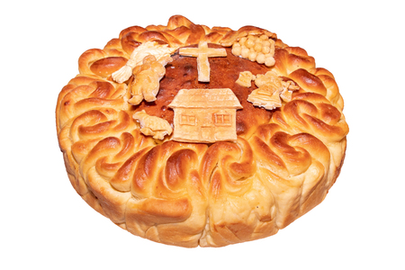 homemade bread korovai for holidays and weddings on the table among the Slavic peoples on a white background
